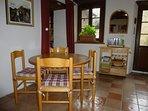 Breakfast table near cooking area