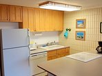 Kitchen with all modern appliances, maple cabinets, large peninsula countertop, smooth-top stove and range, dishwasher...