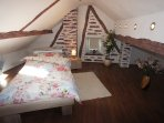 Attic bedroom with 2 x single beds