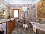The main bathroom with bath and shower on the ground floor