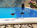 Enjoy your wine at our pool side!
