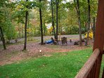 view off porch of firepit and pond