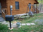 Charcoal grill,picnic table and swing. Hot tub on back deck.