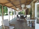 the large wooden veranda invite you to socialise, relax and enjoy the view the view of the château