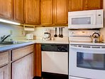 The kitchen w/ upgraded microwave and stove