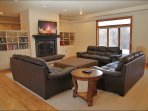 Living Room has a large HDTV and a Gas Fireplace