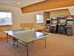 Game Room with Arcade Games, Foos Ball, Ping Pong, and 70 inch TV with video game systems, controllers, games, etc