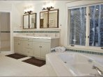 Long Soaker Bathtub, Dual Sinks, Walk In Steam Shower, and Water Closet in the first Master Bathroom