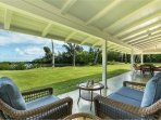Covered lanai on main home, with seating area off of master.