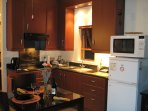 The flat has a fully equipped kitchen with fridge, freezer, convection microwave and hob.