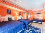 Triple queen bedroom off the pool deck