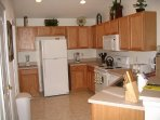 Full kitchen with washer/dryer in room to left