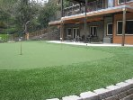View of back patio and putting green