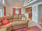 After an active day outdoors, you'll look forward to relaxing on the L-shaped couch next to the fireplace.