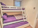 Sleep tight in this bedroom with 2 twin-sized beds and a full-sized trundle.