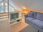 For additional sleeping, head upstairs to the loft and enjoy a good night's rest in the queen-sized sofa bed or...