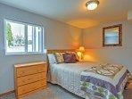 The ground floor bedroom has an additional queen bed!