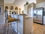 Feast on a delectable home-cooked meal at the kitchen bar with 3 bar stools.