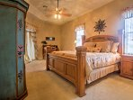 The master bedroom features an en suite bathroom and a cloud-like king-sized bed.