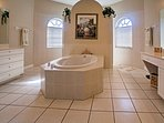 You'll feel like royalty freshening up in this beautiful master bathroom.