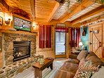 Enjoy a fire in the living room of this cabin near Gatlinburg