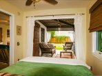 Bedroom opens out into cabana room and yard through double french doors