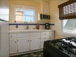 Fully Equipped Kitchen: toaster oven, gas range, cookware, and amenities