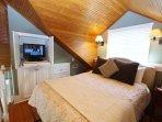 Bedroom Showing TV in Cabinet