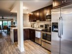 Fully equipped and renovated kitchen with stainless steel appliances