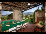 Outdoor covered loggia with magnificent views over the typical Tuscan landscape