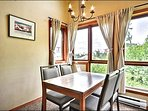 The Dining Area Features Large Windows to Take in the Views While you Dine