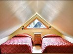 The Loft Area Offers you Two Twin Beds