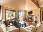 Cozy Living Room with Fireplace and Flat Screen TV