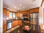 Custom Kitchen with Granite Counter Tops and Stainless Steel Appliances