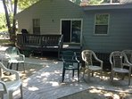 large yard with deck, grill, outside shower and firepit