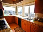 Middle/Entry level kitchen with built in flat griddle cook top, wall oven, breakfast bar for 3 and ocean views