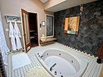Large master bathroom with deep soaker tub, sauna, large shower and walk-in closet