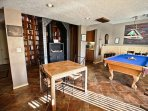 Lower level billiard room with cable flat screen TV/DVD player, pool table, Foos ball table, darts, a plush futon for ...