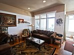 Lower level living room with a wall mounted flat screen TV/VCR/DVD & Blu-Ray DVD player, wood burning fireplace, CD...