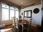 Lower level dining area for 6, spectacular ocean views and french doors leading to ocean facing deck and stone patio