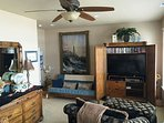 Upper level master bedroom with a King bed, sitting area with a flat screen TV/VCR/Blu-Ray DVD player. I-Pod dock...