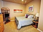 Upper level second bedroom with a King and Twin bed, flat screen TV/Blu-Ray DVD player-door into hall bathroom