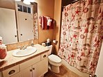 Upper level hall bathroom with a tub/shower combo-door leading into second bedroom