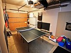 Garage with Ping Pong table, darts and sand toys