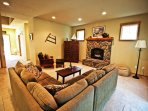 Lower level living room with a flat screen cable TV/VCR/DVD player, surround sound, gas fireplacae, sectional couch ...