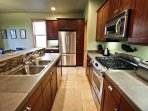 Lower level fully equipped kitchen with stainless steel appliances, granite counter tops, gas cook stove and a ...