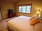 Upper level master bedroom with a King bed, flat screen cable TV/DVD player and a private bathroom