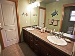 Upper level master bathroom with his & her sinks and a large sit down shower