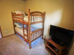 Upper level bedroom with three Twin bunk beds, an extra Twin mattress and a flat screen cable TV/DVD player