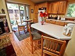 Fully equipped kitchen with breakfast bar for 2, dining area for 2 and a slider leading to back stone patio